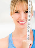 Woman with tape measure Stock Image