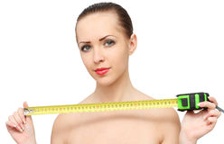 Woman with tape-measure Stock Photography