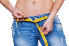 Woman with tape measure before the next diet Royalty Free Stock Images