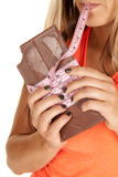 Woman with tape in mouth and around chocolate close Stock Photo