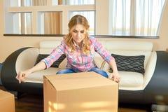 Woman taping cardboard box. Royalty Free Stock Photo