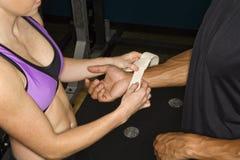 Woman taping wrist. Royalty Free Stock Photo