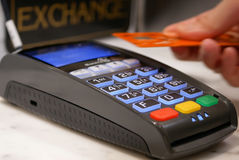 Woman tapping credit card on payment terminal Royalty Free Stock Image