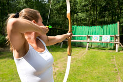 Woman target shooting Royalty Free Stock Photos