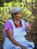 Woman in Tarija drinking from a glass Royalty Free Stock Photography