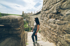 Woman tasks picture in fron of castle Stock Photography