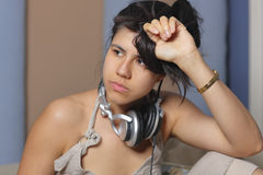 Woman with tassled hair and headphones over her neck Stock Photos