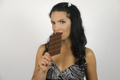 Woman taste chocolate royalty free stock images