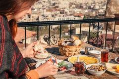 Woman taste traditional turkish breakfast in Cappadocia Stock Photography