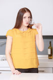 Woman tastes red wine. Wine testing expert. Young brunette woman sipping red wine during degustation and watching at a camera Stock Images
