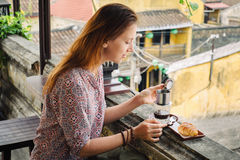 Woman tastes vietnamese coffee Stock Images