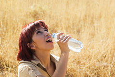 Woman Tastes Water Royalty Free Stock Photos