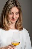 Woman tastes white wine Royalty Free Stock Images
