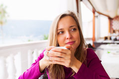 Woman tasting coffee Stock Photos