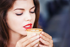 Woman tasting coffee Stock Images