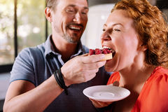 Woman tasting a delicious cake Stock Image