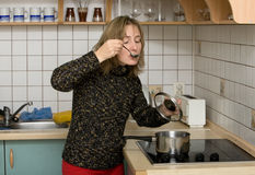 Woman tasting dinner Stock Photography