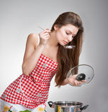 Woman tasting food Royalty Free Stock Images