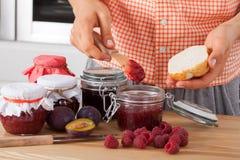 Woman tasting fresh jam. Woman tasting fresh homemade raspberry jam Royalty Free Stock Image