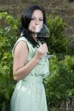 Woman tasting a glass of red wine Royalty Free Stock Photos