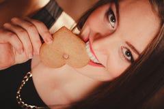Woman tasting heart cake Stock Photo