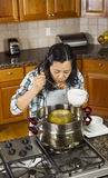 Woman Tasting Her Cooking of the Winter Melon Royalty Free Stock Image