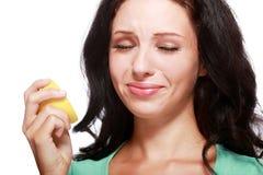 Woman tasting lemon Royalty Free Stock Photography