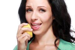 Woman tasting lemon Royalty Free Stock Photo