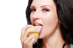 Woman tasting lemon Royalty Free Stock Image