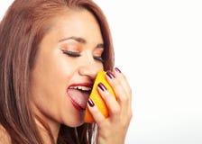 Woman Tasting Orange Royalty Free Stock Image
