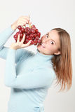 Woman tasting red grapes Stock Images