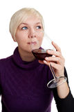 Woman tasting red wine Royalty Free Stock Photos