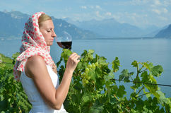 Woman tasting red wine Royalty Free Stock Image