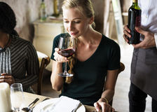 Woman Tasting Red Wine in a Classy Restaurant stock photography