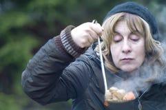 Woman tasting soup Stock Image