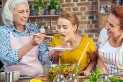Woman tasting vegetable salad Stock Image