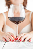 Woman tasting wine on bright background Stock Photos