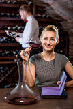 Woman tasting wine in the cellar. Young women tasting wine in the cellar. Wine degustation Stock Photo