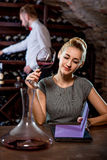 Woman tasting wine in the cellar Stock Photos