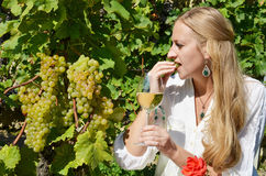 Woman tasting wine Royalty Free Stock Images