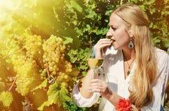 Woman tasting wine Stock Image