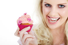 Woman with tasty cupcake Royalty Free Stock Image