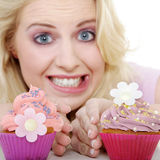 Woman with tasty cupcake Royalty Free Stock Images