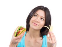 Woman with tasty fast food unhealthy burger Royalty Free Stock Photography