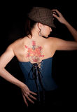 Woman with tatoo on her back Royalty Free Stock Photography