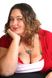 Woman with tattoo. Attractive large woman with a tattoo on her chest royalty free stock photos