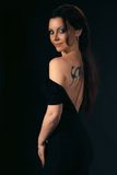 Woman with tattoo. Portrait of a woman with a tattoo on his back stock photography