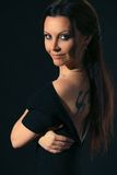 Woman with tattoo. Portrait of a woman with a tattoo on his back royalty free stock image