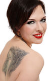 Woman with tattoo. Attractive smiling woman with tattoo of wolf on her shoulder stock photos