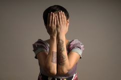 Woman with tattoo on arms. Woman with tattoo on her arms on grey background Royalty Free Stock Image